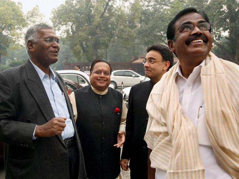 MoS for Finance SS Palanimanickam, MoS Jitin Prasada, Congress MP Vijay Darda and CPI leader D Raja at Parliament House. The issue of Walmart lobbying to open the way for FDI in retail in India rocked both houses of Parliament as the Opposition sought a probe into the matter. (PTI Photo)