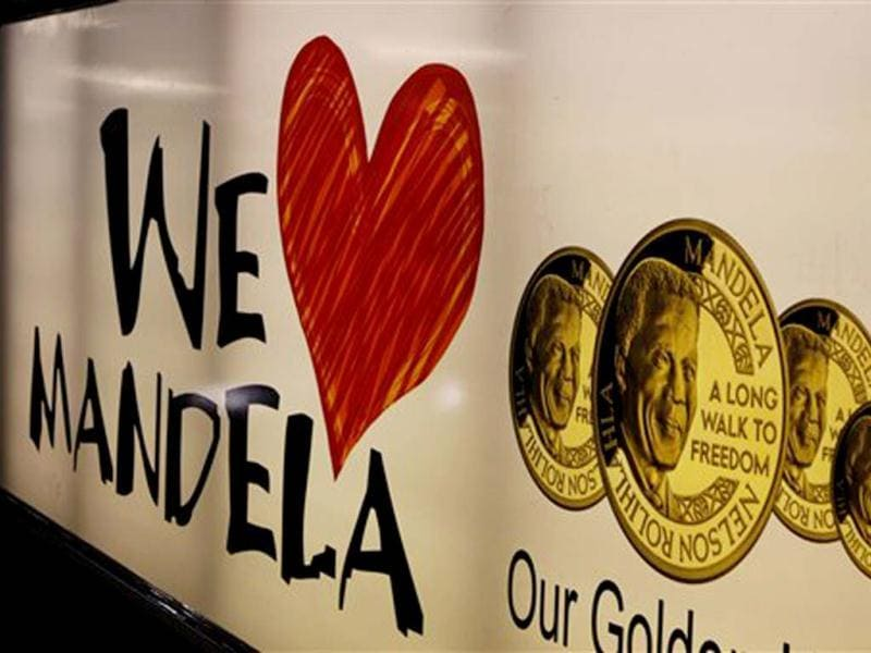 A banner advertising gold coins with the image of former South African president Nelson Mandela, in Johannesburg. (AP file photo)