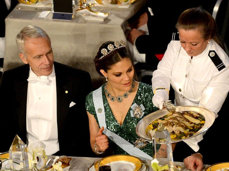 The 2012 Nobel Chemistry Prize winner Brian K Kobilka (L) and Princess Victoria of Sweden (R) attend the Nobel Banquet, a traditional dinner after the Nobel Prize awarding ceremony at the Stockholm City Hall. AFP PHOTO/JONATHAN NACKSTRAND