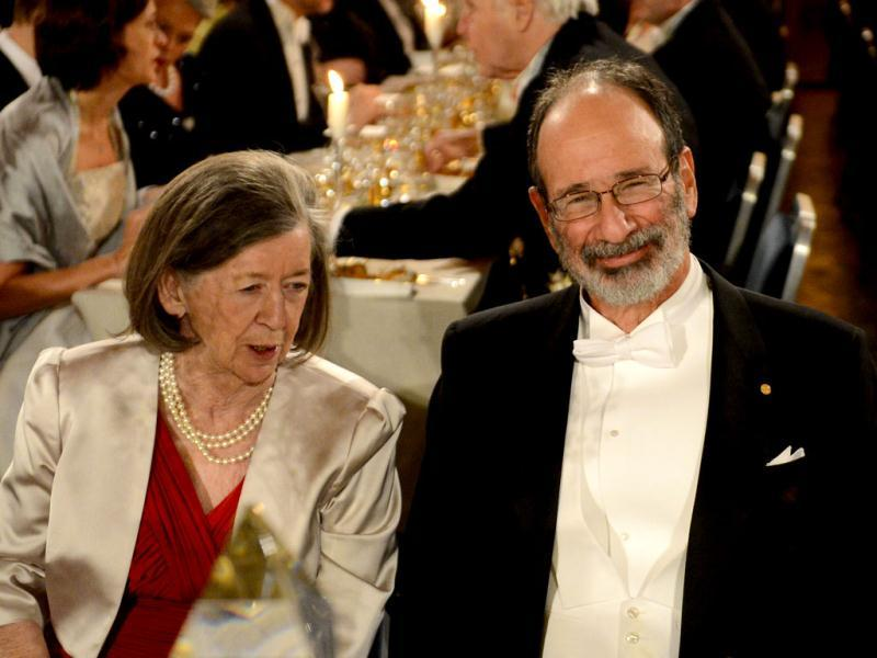 The 2012 Nobel Literature Prizewinner Economics Alvin E Roth (R) reacts during the Nobel Banquet, a traditional dinner after the Nobel Prize awarding ceremony at the Stockholm City Hall, Sweden. AFP PHOTO/JONATHAN NACKSTRAND