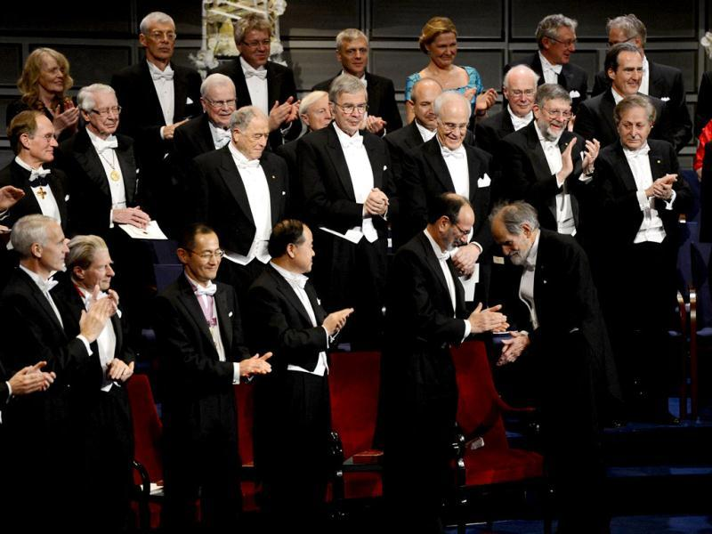 (1st row L-R) The Nobel 2012 Chemistry laureate Brian K Kobilka, the Nobel 2012 Physiology or Medecine laureates John B Gurdon of England and Shinya Yamanaka of Japan, the 2012 Nobel Literature Prize winner Mo Yan of China applaud the 2012 Nobel laureates in Economics Alvin E. Roth and Lloyd S. Shapley at the Nobel prize awarding ceremony in Stockholm. The winners of the Nobel Prize 2012 in the categories of medicine, physics, chemistry, literature and economics receive their awards from the hands of Sweden's King Carl XVI Gustaf at a formal ceremony, followed by a gala banquet. AFP PHOTO/JONATHAN NACKSTRAND