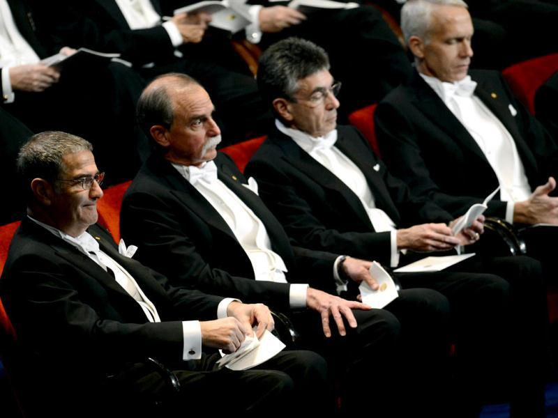 (1st row L-R) The Nobel 2012 laureates in physics Serge Haroche of France, David Wineland of US, the Nobel 2012 Chemistry laureates Robert J Lefkowitz and Brian K Kobilka attend the Nobel prize awarding ceremony in Stockholm. AFP PHOTO/JONATHAN NACKSTRAND