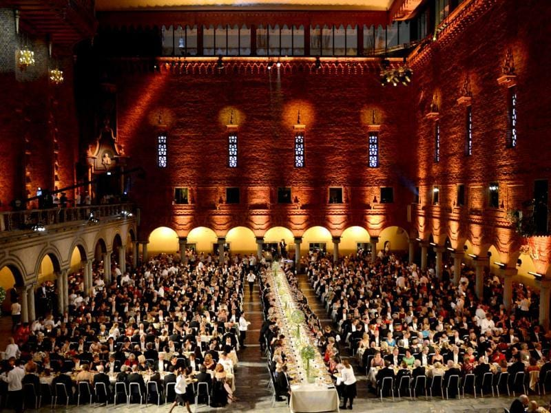 An overview of the Nobel banquet is pictured, a traditional dinner after the Nobel Prize awarding ceremony at the Stockholm City Hall. The winners of the Nobel Prize 2012 in the categories of medicine, physics, chemistry, literature and economics received their awards from the hands of Sweden's King Carl XVI Gustaf at a formal ceremony, followed by a gala banquet. AFP PHOTO/JONATHAN NACKSTRAND