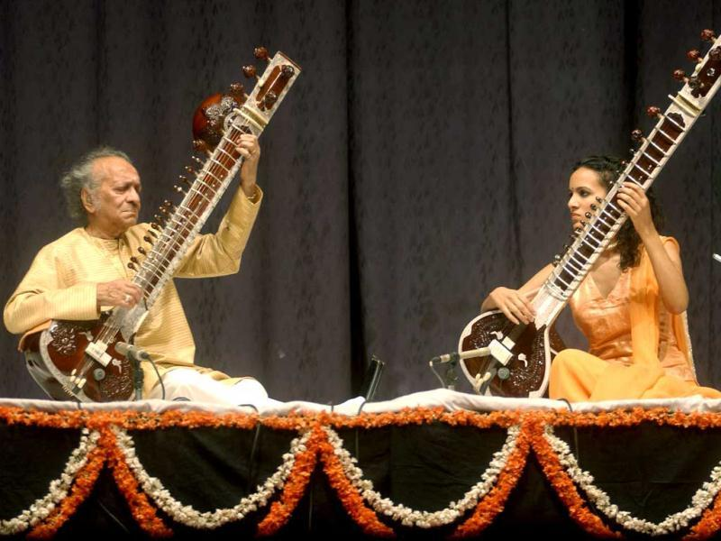 In this photograph taken on February 25, 2004, Indian classical musician Ravi Shankar (L) and his daughter Anoushka Shankar play sitars as they perform at a function to pay tribute to Beatle George Harrison on the anniversary of his birthday in New Delhi.