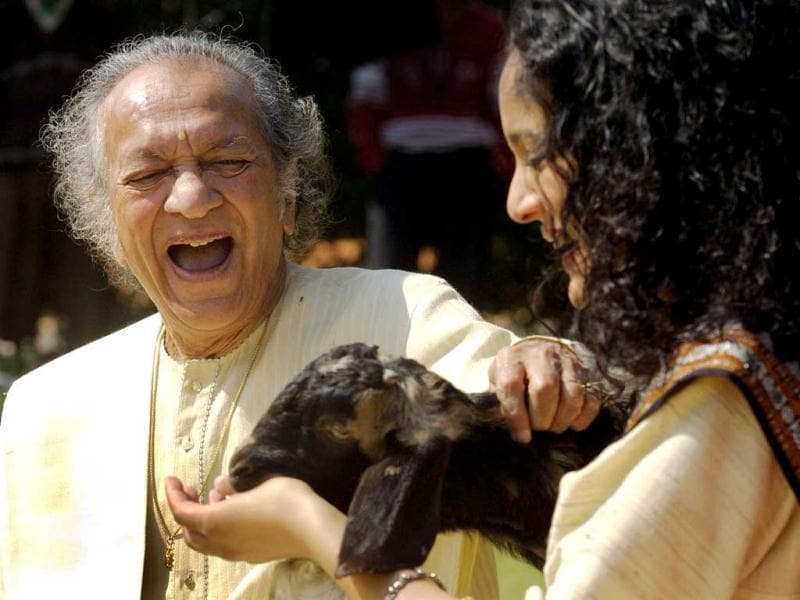In this Feb. 25, 2002 file photo, Sitar maestro Pandit Ravi Shankar, left, and his daughter Anoushka Shankar laugh during the shooting of a film endorsing the strengthening of Indian laws against animal cruelty in New Delhi. (AP Photo)