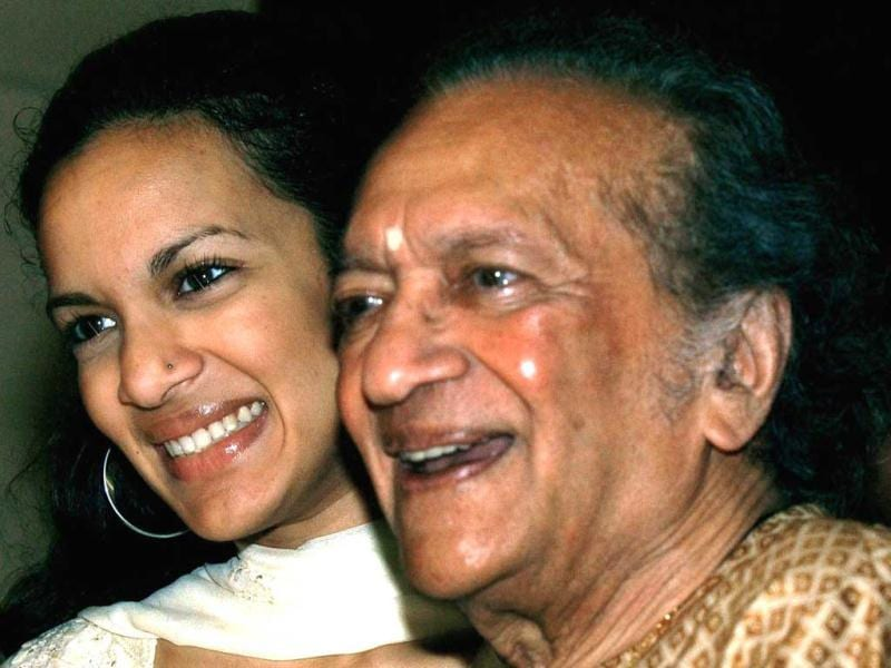 In this Dec. 19, 2002, Indian Sitar maestro Ravi Shankar, right, and daughter Anoushka Shankar smile during a press conference in Calcutta, India. (AP Photo)