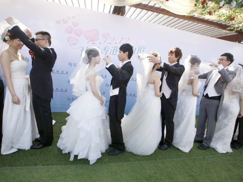 Twelve couples attend a mass wedding ceremony at the Peak in Hong Kong to mark the unique date of 12-12-12. (AP Photo)