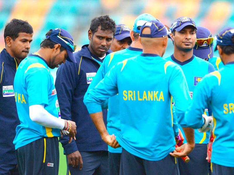 Sri Lanka's cricket team huddle during training in Hobart. Australia plays Sri Lanka in their 3-test match series with the first test starting Friday. AP photo