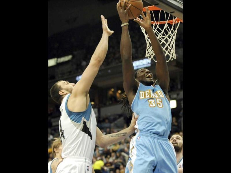 Denver Nuggets' Kenneth Faried shoots against Minnesota Timberwolves' Nikola Pekovic, of Montenegro, during the third quarter of an NBA basketball game at the Target Center. The Timberwolves won 108-105. AP
