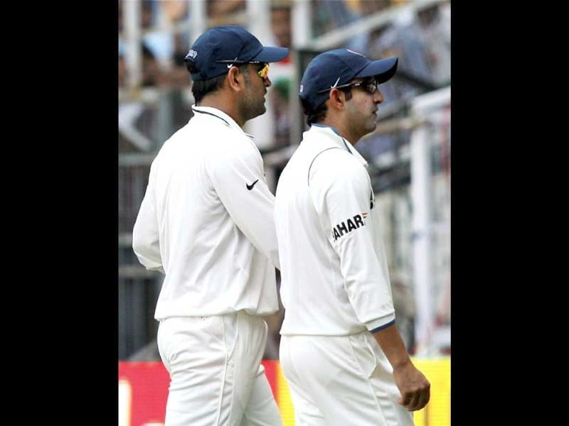 Skipper MS Dhoni and Gautam Gambhir walk off the field during lunch on the first day of fourth cricket test match between England and India in Nagpur on Thursday. PTI Photo