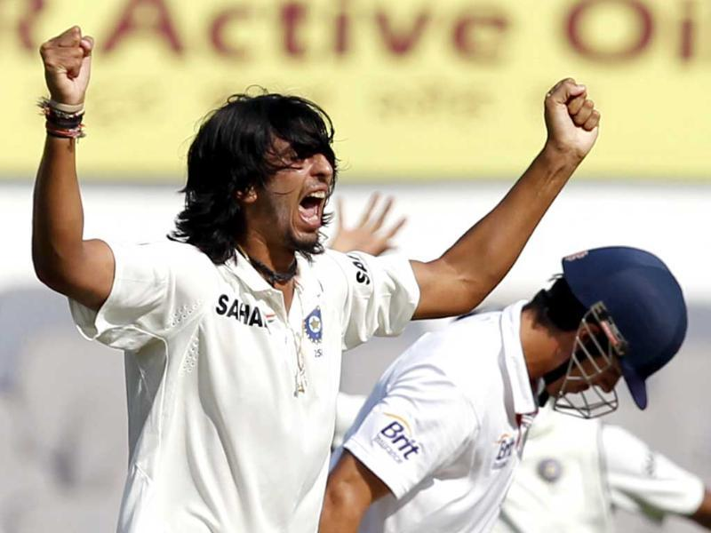 Bowler Ishant Sharma celebrates after dismissing England captain and batsman Alastair Cook on the first day of the fourth Test match between India and England at VCA stadium, in Nagpur. HT Photo/Santosh Harhare