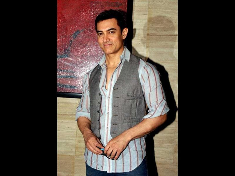 Aamir Khan is all smiles for the camera at the Talaash party.