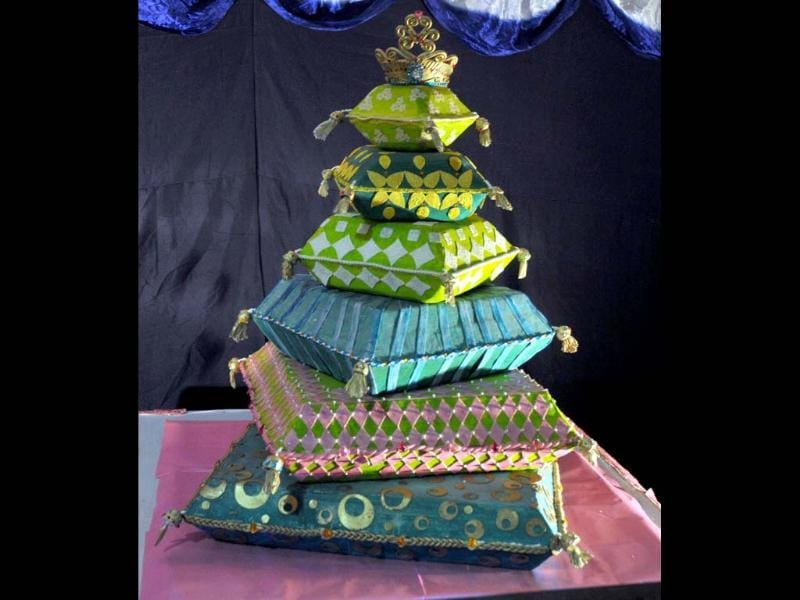 A six-tier cake of a crown placed on cushions made by Nilgiri's bakery on display at the 38th Annual Cake Exhibition held as a part of Christmas and New Year celebrations in Bangalore. UNI