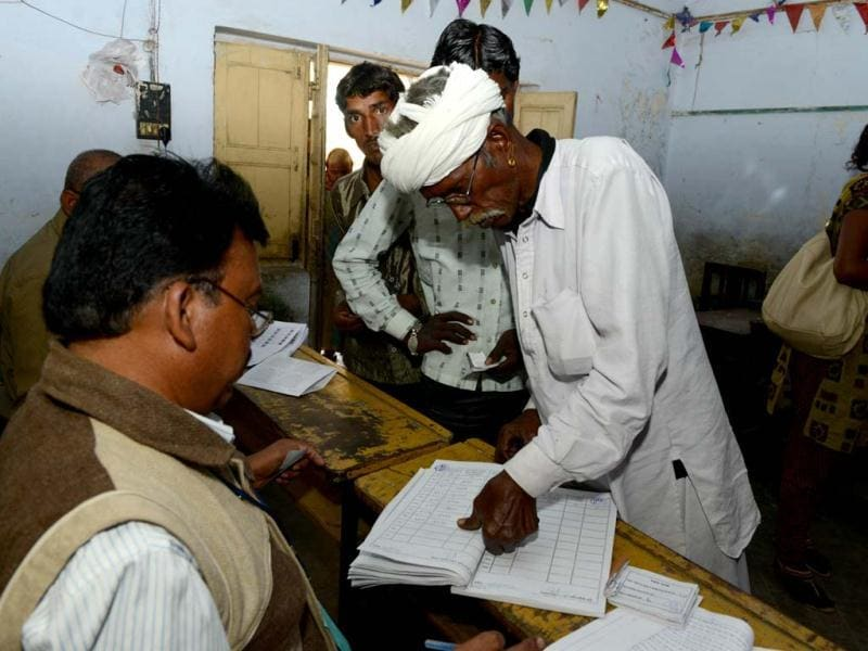 An elderly man places his thumb print on a register book before casting his vote in the state assembly elections at Sanand town, some 30 kms from Ahmedabad. The first phase of voting in state assembly elections in Gujarat started with the next phase on December 17, 2012. AFP Photo