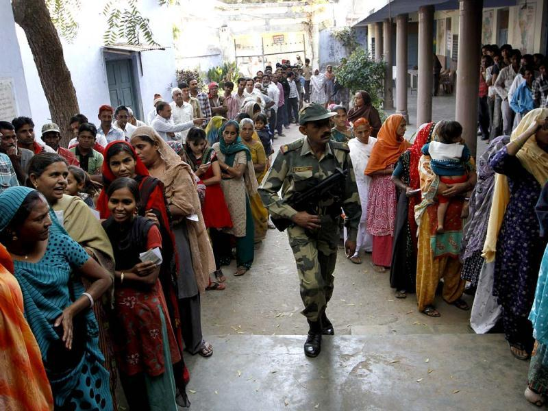 Voters standing in queue during the first phase polling of Gujarat assembly election in Ahmedabad, Gujarat. HT/Arijit Sen