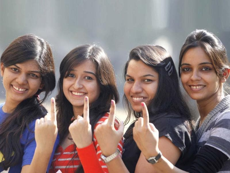 Young voters show off their marked fingers after casting their votes in the state assembly election in Surat, Gujarat. HT/Satish Bate