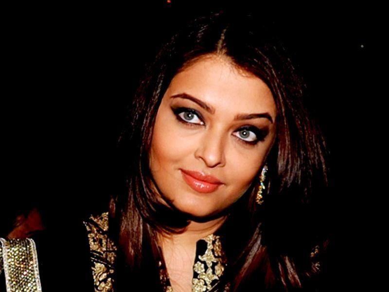 Aishwarya Rai Bachchan stuns in a black anarkali as she attends the unveiling of the book My Father, Our Fraternity by Indian classical Sarod musician, Ustad Amjad Ali Khan. Check her out with hubby Abhishek and father-in-law Amitabh Bachchan. (AFP Photo)