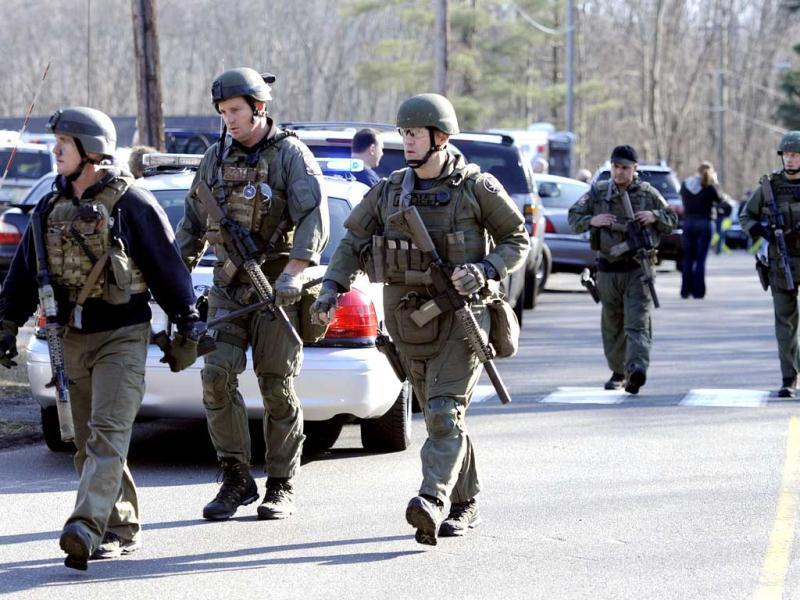 State Police are on scene following a shooting at the Sandy Hook Elementary School in Newtown, Connecticut, about 60 miles (96 kilometers) northeast of New York City. AP Photo/Jessica Hill