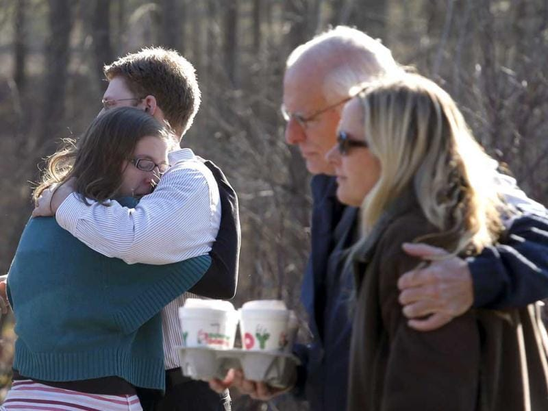 Family members embrace each other outside Sandy Hook Elementary School after a shooting in Newtown, Connecticut. REUTERS/Adrees Latif