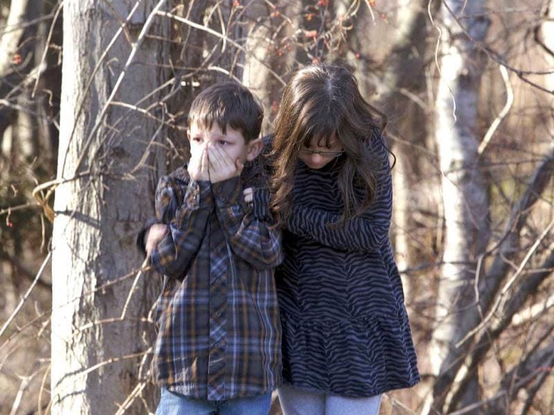 Young children wait outside Sandy Hook Elementary School after a shooting in Newtown. A shooter opened fire at the elementary school in Newtown, Connecticut, killing several people including children, the Hartford Courant newspaper reported. REUTERS/Michelle McLoughlin