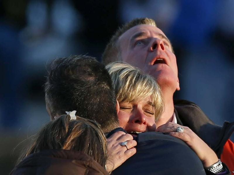 The families of victims grieve near Sandy Hook Elementary School, where a gunman opened fire on school children and staff in Newtown, Connecticut. REUTERS/Adrees Latif