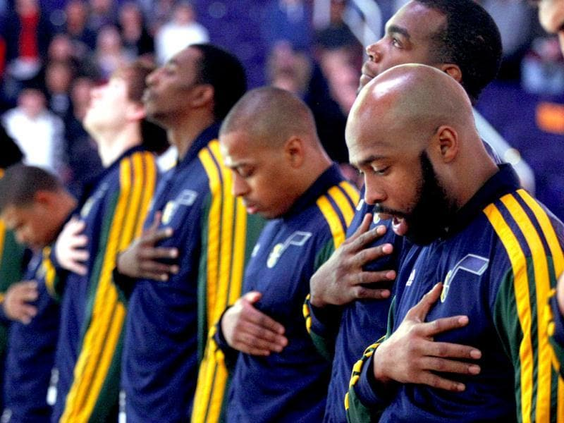 Utah Jazz point guard Jamaal Tinsley and teammates take a moment of silence before an NBA basketball game against the Phoenix Suns on behalf of the school shooting victims in Connecticut in Phoenix. AP photo