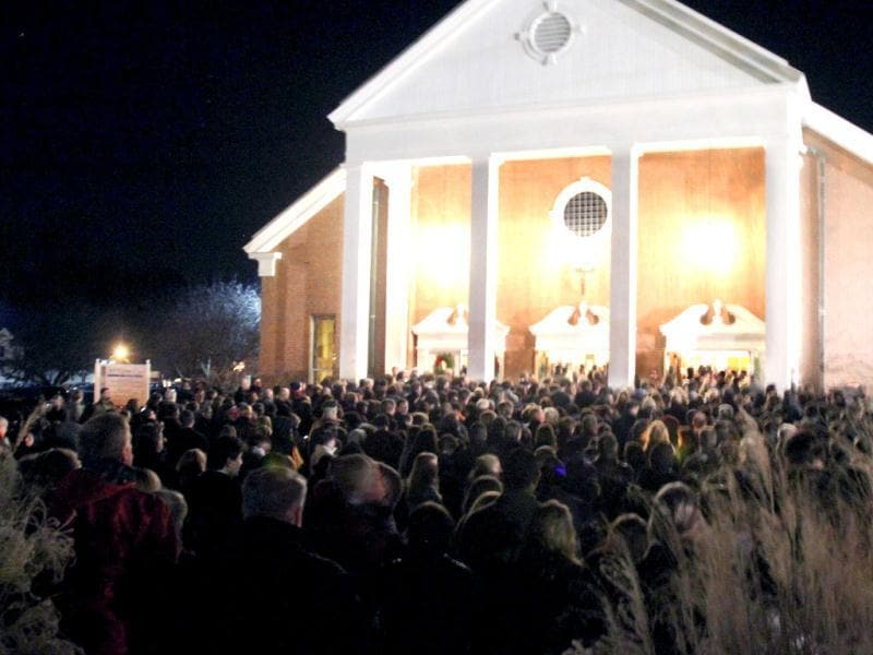 Thousands attend a vigil for the victims of the school shooting at Saint Rose of Lima church in Newtown, Connecticut. AP photo