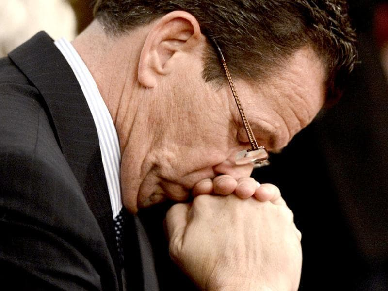 Connecticut governor Dannel Malloy bows his head during a moment of silence during a vigil service for victims of the Sandy Hook Elementary School shooting, at the St. Rose of Lima Roman Catholic Church in Newtown, Connecticut. AP photo