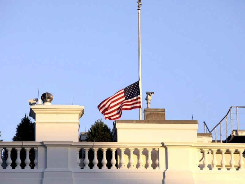 A US flag flies at half staff at the White House in Washington. A tearful President Barack Obama expressed 'overwhelming grief' for the victims of a shooting rampage at Sandy Hook Elementary School. Reuters