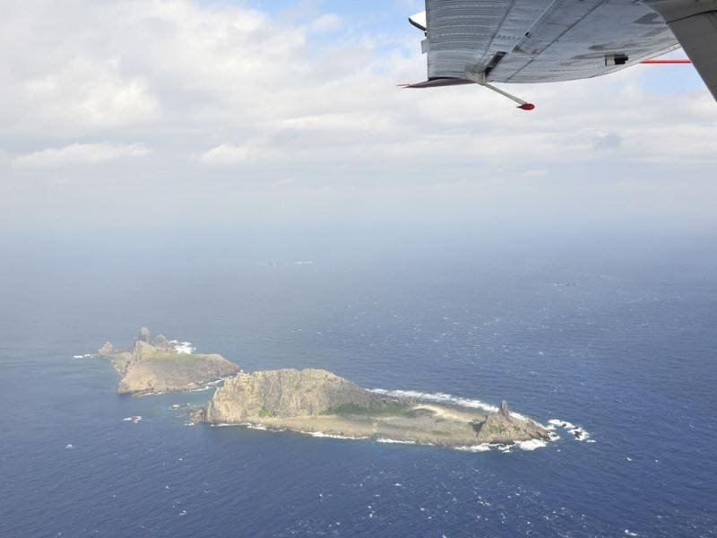 Part of small islands in the East China Sea known as Senkaku in Japanese and Diaoyu in Chinese is pictured from Chinese marine surveillance plane B-3837. hina for the first time dispatched a plane over the disputed islands on Thursday, prompting Tokyo to accuse it of violating Japanese air space. (AP Photo)