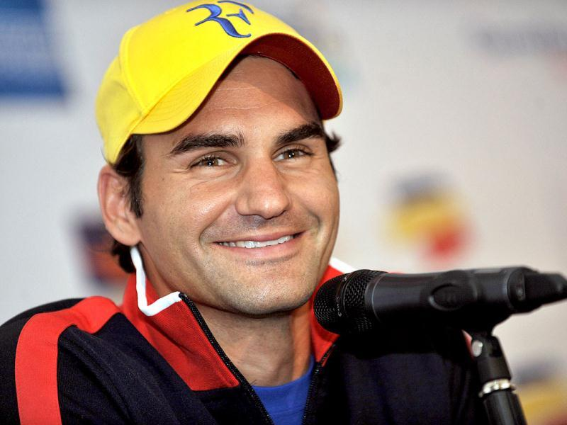 Swiss tennis player Roger Federer gestures during a press conference in Bogota, Colombia, ahead of an exhibition match that he will play on saturday with french tennis player Jo-Wilfried Tsonga at El Campin Coliseum of Bogota. (AFP Photo)