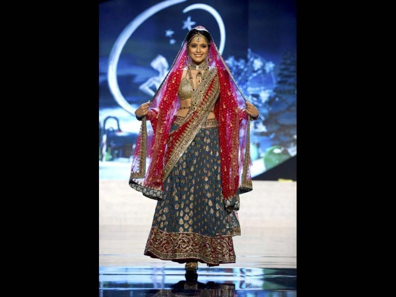 Miss India Shilpa Singh performs onstage at the 2012 Miss Universe National Costume Show in Las Vegas. The 89 Miss Universe Contestants will compete for the Diamond Nexus Crown on December 19, 2012. (Reuters)