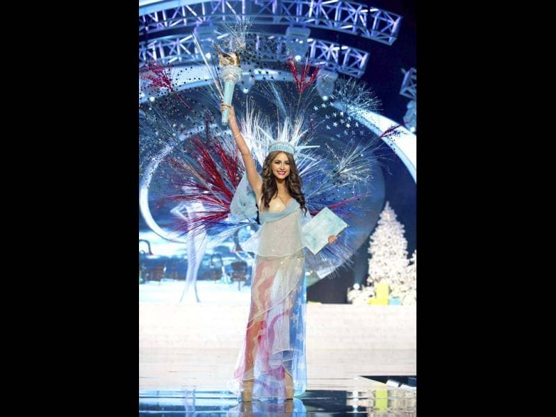 Miss USA Olivia Culpo waves proudly in a costume representing her country at the 2012 Miss Universe National Costume Show at PH Live in Las Vegas. The 89 contestants showcased the best of their countries wearing their national costumes at the competition. (Reuters)