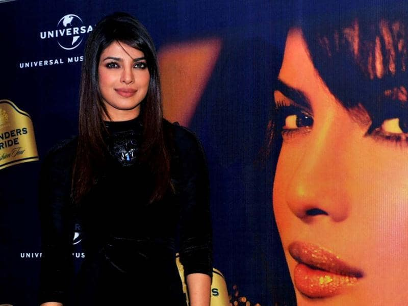 Bollywood diva Priyanka Chopra stuns in a short black dress as she attends a press conference for Blender's Pride Fashion Tour in Mumbai on December 14. Check out the curvacious actress at the event! (AFP Photo)