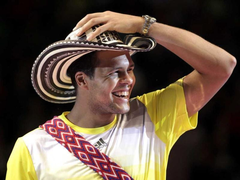 France's tennis player Jo-Wilfried Tsonga smiles as he wears a traditional Colombian hat after an exhibition match against Switzerland's Roger Federer in Bogota, Colombia. AP photo