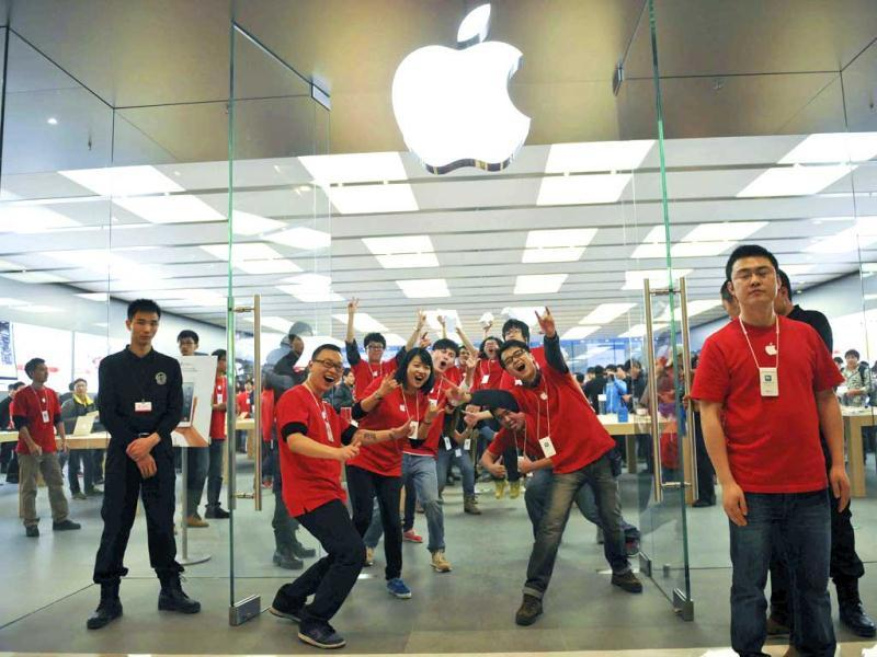 Chinese employees pose for photographers at the newly opened Apple Store at the MixC mall in Chengdu in southwest China's Sichuan province. AP photo