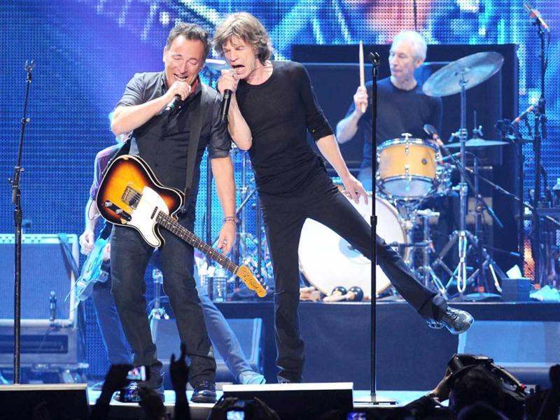 Musician Bruce Springsteen, left, performs with Mick Jagger during the Rolling Stones final concert of their