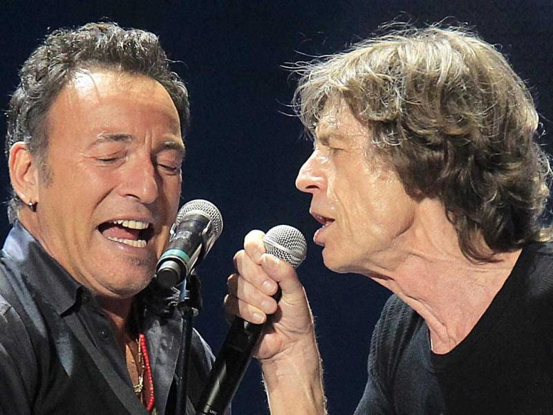 Mick Jagger(R) and Bruce Springsteen perform onstage during the Rolling Stones final concert of their