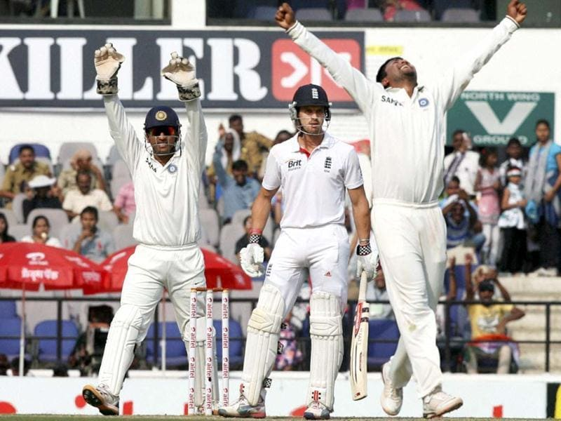 MS Dhoni and Pragyan Ojha celebrate the dismissal of England batsman Nick Compton during their last Test match at the VCA Stadium in Nagpur. (PTI Photo)