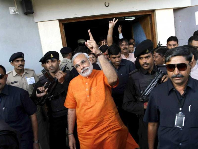 Gujarat chief minister Narendra Modi gestures as he greets his supporters after casting his vote in the second phase of Gujarat state assembly elections in Ahmadabad. AP Photo/Ajit Solanki