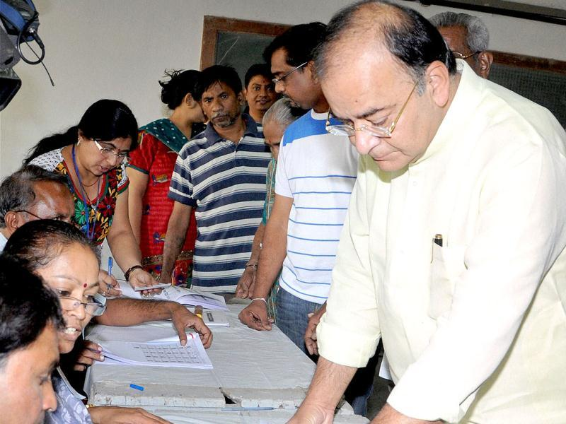 Senior BJP leader Arun Jaitley gets his finger marked with indelible ink prior to casing his vote at a polling station for the second phase of Gujarat Assembly elections in Ahmedabad on Monday. (PTI Photo)