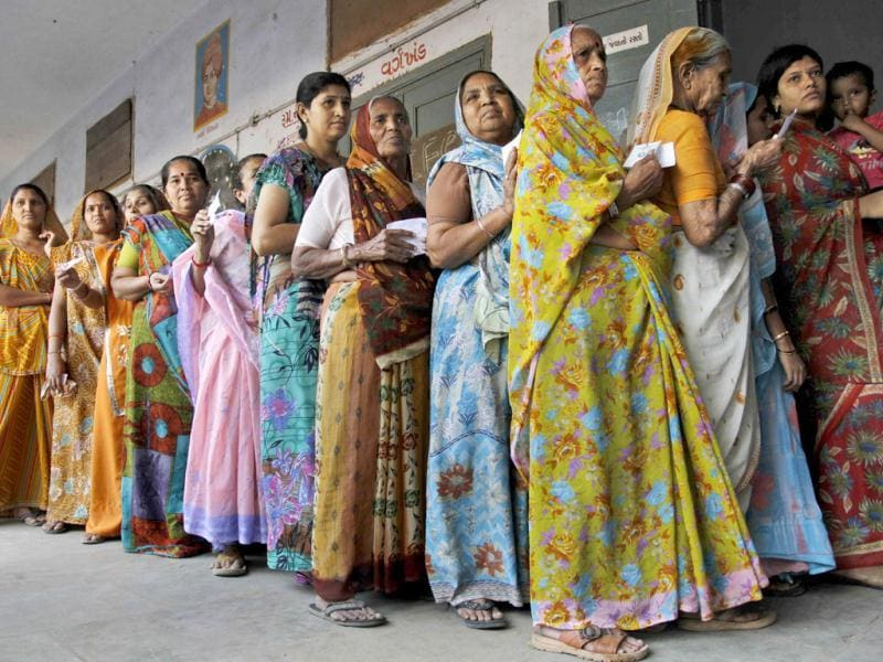 Indian women stand in queue to cast their votes for the second phase of Gujarat state assembly elections in Ahmedabad. An estimated 70% cast their ballots in the second and final phase of polling held in 95 constituences of the state. (AP Photo)