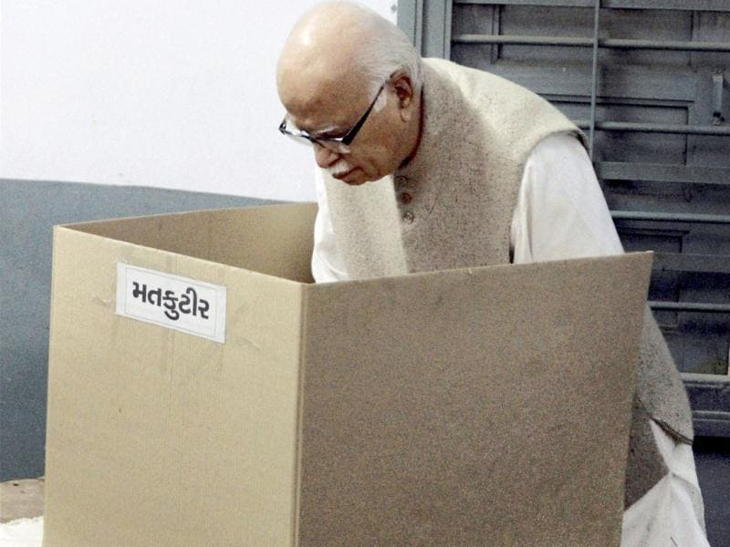 Senior BJP leader LK Advani casts his vote at a polling station for the second phase of Gujarat Assembly elections in Ahmedabad. Exit and opinion polls on television channels at the end of voting in Gujarat have projected BJP to perform a hat-trick in the state. (PTI Photo)