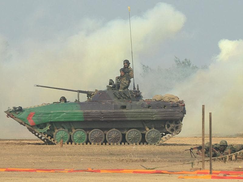 Indian soldiers perform a demonstration drill during an Army Mela (fair) and exhibition at Khasa, some 15 kms from Amritsar. The Army Mela (fair ), organised by the Vajra Corps, displayed weapons, tanks, aircraft and military equipment to students and civilian visitors of the event. AFP PHOTO/ NARINDER NANU