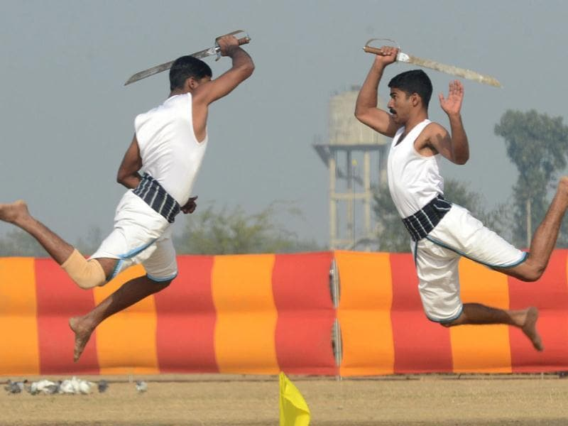Soldiers perform the Indian martial art Kalaripayattu during an Army Mela (fair) and exhibition at Khasa, some 15 kms from Amritsar. The Army Mela (fair ), organised by the Vajra Corps, displayed weapons, tanks, aircraft and military equipment to students and civilian visitors of the event. AFP PHOTO/ NARINDER NANU