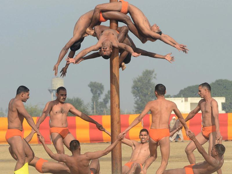 Soldiers perform the mallakhamb during an Army Mela (fair) and exhibition at Khasa, some 15 kms from Amritsar. The Army Mela (fair ), organised by the Vajra Corps, displayed weapons, tanks, aircraft and military equipment to students and civilian visitors of the event. AFP PHOTO/ NARINDER NANU