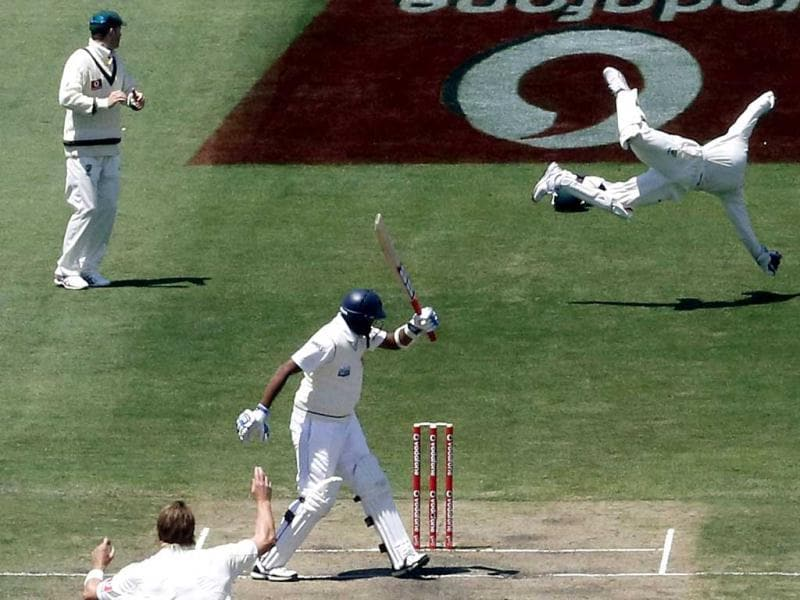 Australia's wicketkeeper Matthew Wade (R) dives to try and stop a shot by Sri Lanka's Thilan Samaraweera (C) during their fifth day of play in the first cricket test at Bellerive Oval in Hobart. Reuters