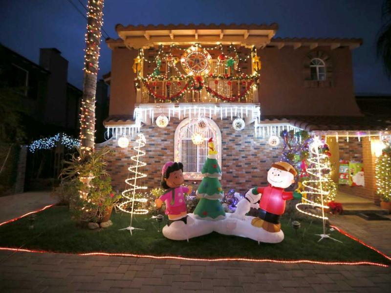 Christmas lights and decorations are displayed outside the house of Aleli Estacio, who said she has been putting up the display for 40 years, in Pasadena, California. Reuters