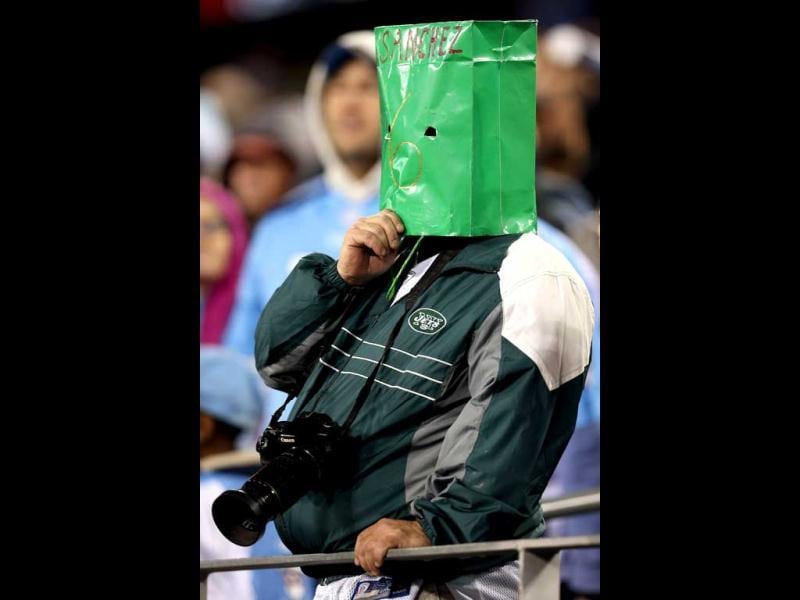 A New York Jets fans wears a green bag over his head with Sanchez and the #6 on it against the Tennessee Titans at LP Field in Nashville, Tennessee. AFP photo