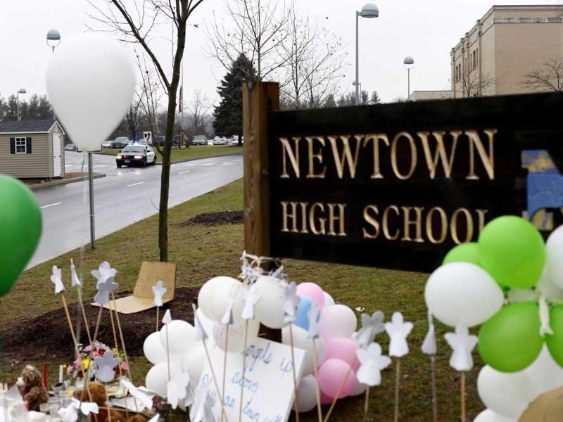 A police car is seen positioned outside Newtown High School in Newtown, Connecticut. Reuters/Joshua Lott